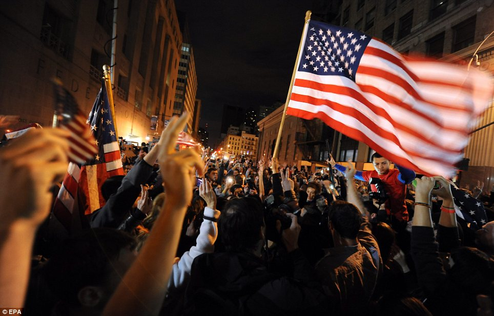 Celebration: Crowds at Ground Zero in New York City in the early hours today, shortly after President Barack Obama announced that a US military operation had killed Osama bin Laden in a firefight in Pakistan
