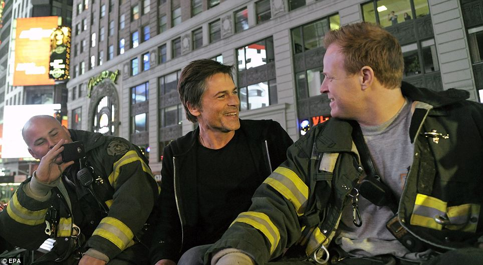 fancy that! Actor Rob Lowe joined New York City Firefighters in Times Square to cheer the news of the death of Al Qaeda Leader