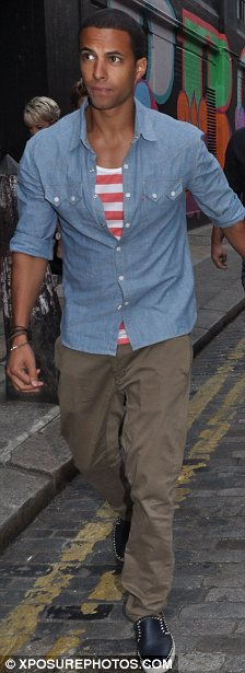 Keeping things covered: Marvin usually has his chest on show but wrapped up for his night out last night