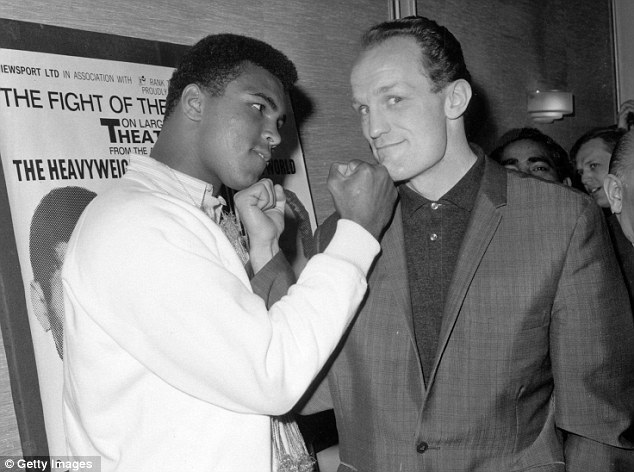 Showstoppers: Muhammad Ali and Henry Cooper square up before their  title fight in 1963