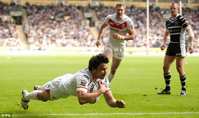 Going over: Ade Gardner scores a second half try for St Helens