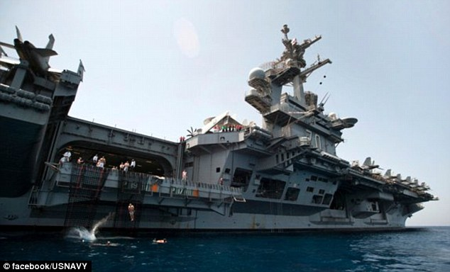 Calm before the storm: Two weeks before Osama bin Laden's corpse was loaded onto their ship, sailors from USS Carl Vinson enjoy a 'Swim Call' day off