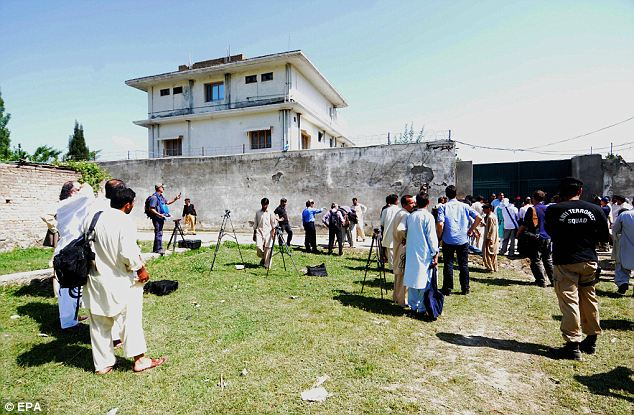 Raided: Pakistani security officials granted access to journalists to cover the compound where Osama Bin Laden was killed