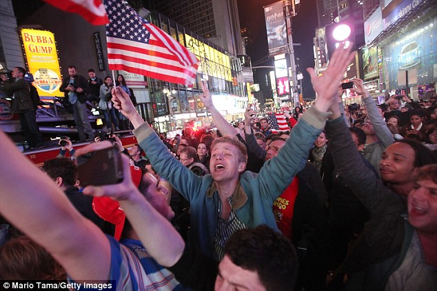 Jubilant: Times Square in New York is packed with people celebrating Bin Laden's death