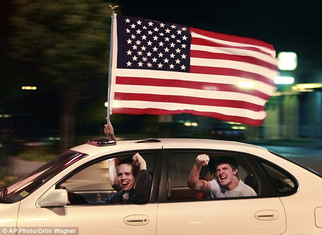 A driver and passengers celebrate the death of Osama bin Laden in the streets of Lawrence, Kansas