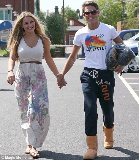 Who wears the trousers? Joey Essex does, as he proved as he defied girlfriend Sam Faiers' ban on his orange Ugg boots out in Brentwood, Essex, yesterday