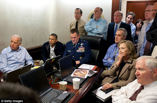Tense moments: Gathered in The White House Situation Room, Barack Obama, Vice President Joe Biden, Secretary of State Hillary Clinton and members of the national security team watch the mission unfold on a live feed