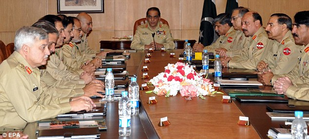 Making decisions: General Kayani (centre) holds talks with Corps Commanders in the aftermath of the killing of Bin Laden, with threats to withdraw intelligence support to the U.S.