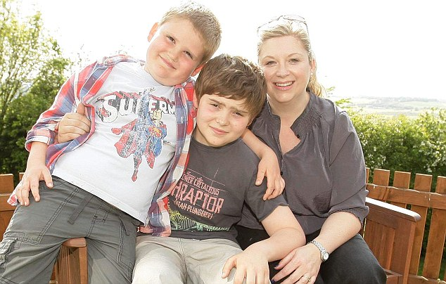 Saviour: Michelle Whitaker with her sons Charlie, middle, whose life has been saved by his saviour sibling James, left
