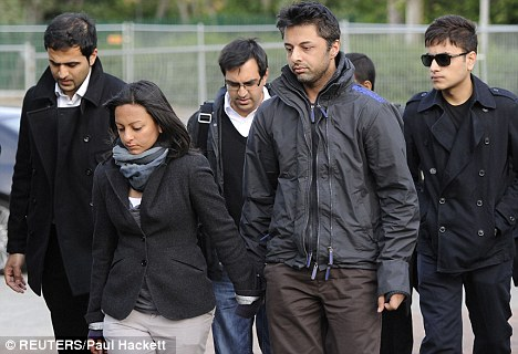 Strain: Shrien Dewani (second right) arrives with supporters for his extradition hearing in London