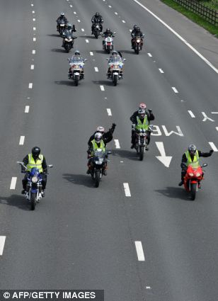 Anger: A group of motorcyclists join the ranks of motorists in the 20mph 'go slow' protest across motorways in North Wales and the North West