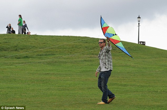 Let's go fly a kite! Despite the cloudy day, the rockstar family enjoyed the famous park