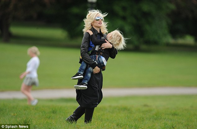 Day in the park: Gwen Stefani carries her son Zuma in Primrose Hill today