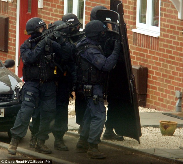 Man power: Dozens off officers were on the scene as the siege progressed on a quiet Norwich street