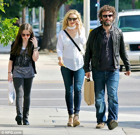 Meet the daughter: Michael Sheen and his girlfriend Rachel McAdams are spotted shopping with his daughter Lily