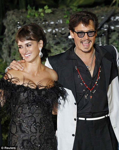 Firm friends: Penelope Cruz, seen here with Johnny Depp at the Pirates Of The Caribbean: On Stranger Tides premiere in Los Angeles last week, said he's always making her laugh