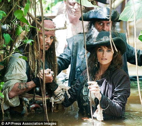 On set: Johnny, Penelope and Ian McShane in a still from the forthcoming new movie