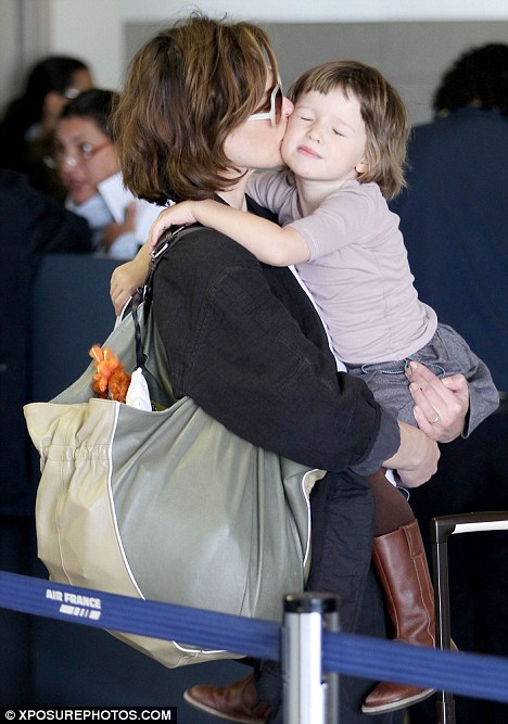 Feeling the love: Ever closes her eyes as her mother plants a smacker on her face