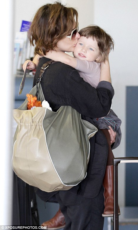 I've got you babe: The Resident Evil star returned the affection and planted a kiss on her toddler's cheek