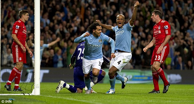 Over to you: Kompany (centre right) will let Carlos Tevez (centre left) lift the trophy if City beat Stoke