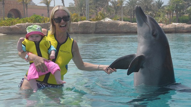 Denise with Betsy and a dolphin