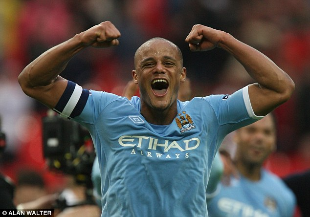 Happy days: Vincent Kompany celebrates after Manchester City beat Manchester United to reach the final
