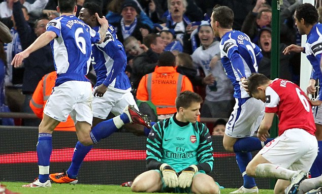 Meltdown: Arsenal inexplicably lost to Birmingham City in the Carling Cup final