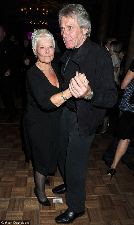A night on the tiles: Dame Judi dancing with wildlife conservationist David Mills