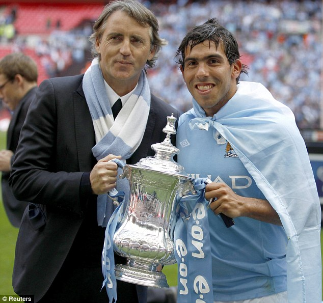 Double act: Carlos Tevez (right) and Roberto Mancini pose with the FA CupDouble act: Carlos Tevez (right) and Roberto Mancini pose with the FA Cup
