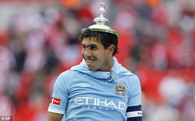 Suits you! Tevez parades the top of the FA Cup at Wembley