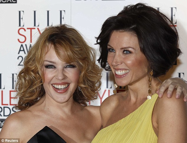 Sister act: Dannii Minogue, right, now has a higher profile in the UK than sister Kylie thanks to her role on The X Factor and modelling for Marks & Spencer