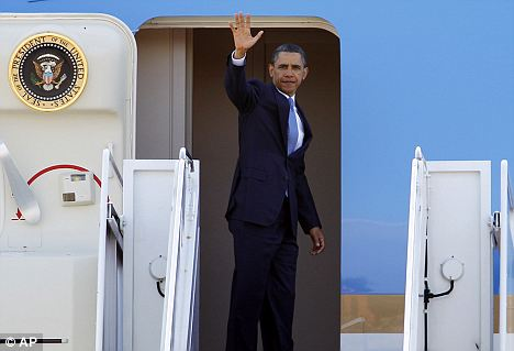 Departing: President Barack Obama waves from Air Force One before departing for Memphis today