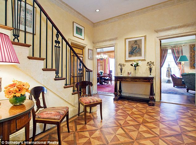 The two story apartment even comes with its own wine cellar and gymnasium