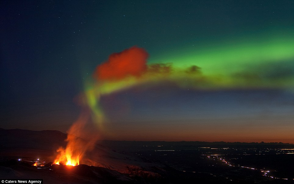 Northern Lights: The Icelandic photographer manages to capture the magical Aurora Borealis over the top of a flaming volcano