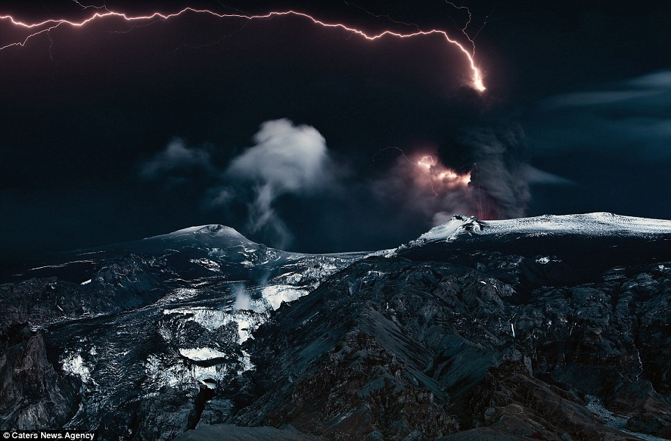 Illuminating: Lightening forks the sky as black smoke billows out of the volcano