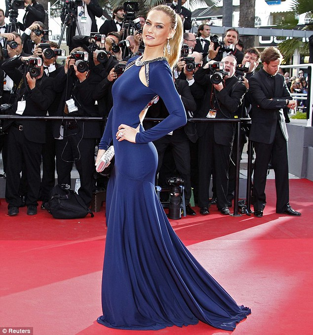 Sexy and single: Meanwhile Leo's ex Bar Refaeli swept on to the red carpet at the Cannes Film Festival, arriving solo to the premiere of The Beaver
