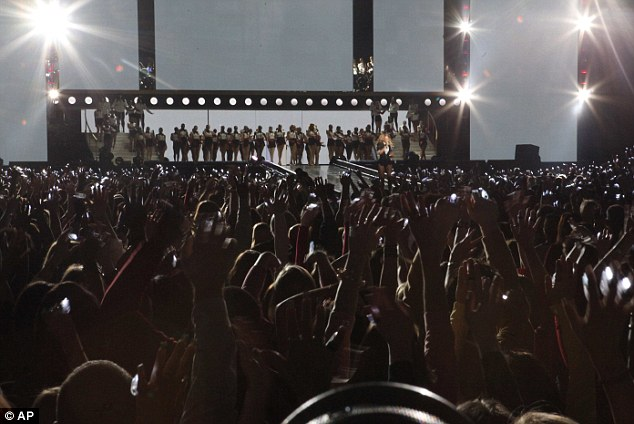 Hands in the air: Beyonce and her dancers get a big reception