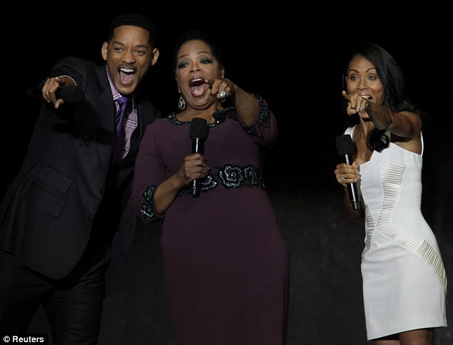 Here's looking at you: Will Smith and wife Jada spot another guest about to pay tribute to Oprah