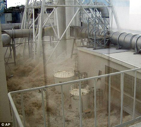 Water rushes into the plant in this photo taken from the fourth floor of the radioactive waste disposal building