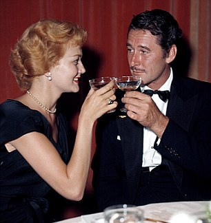 Errol Flynn with his then wife Patrice in the Fifties