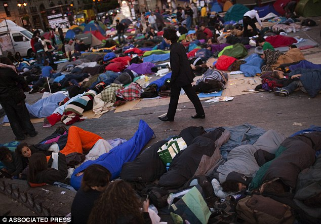 Record-breaking sleepover: Demonstrators brought sleeping bags  to make their all-nighter at Madrid's  Puerta del Sol square more comfortable