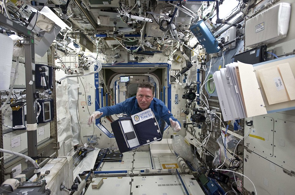 Heavy workload: European Space Agency astronaut Roberto Vittori of Italy floats through the Destiny laboratory of the International Space Station