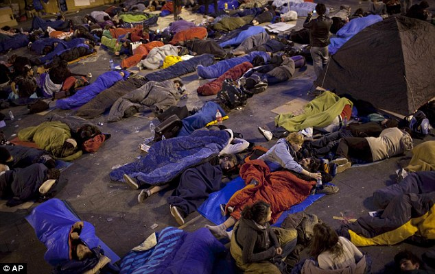 Bedded down for the night: The sit-in ended peacefully after authorities decided not to try and move the demonstrators on