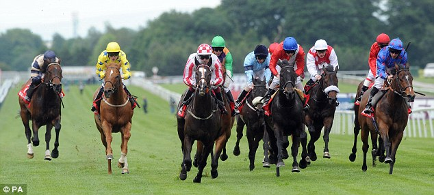 Sprint king: Sole Power, ridden by Keagan Latham (centre, red and white check cap) takes the Temple Stakes