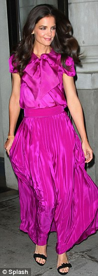 Fabulous in fuchsia: The pleated dress clung to Katie's slim figure as she arrived at the event