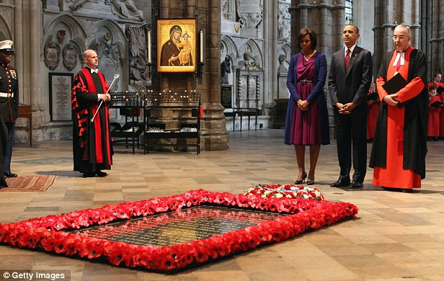 Mark of respect: President Obama continued the presidential tradition by laying a wreath at the tomb of the Unknown Soldier in Westminster Abbey, as he was greeted by the dean, Dr John Hall, right