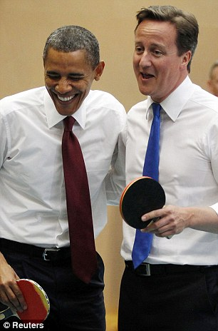 Barack Obama and David Cameron playing table tennis with students at a London school