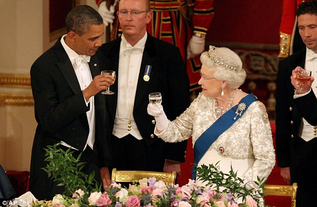 Cheers: President Obama toasts Queen Elizabeth II during a state banquet in Buckingham Palace on Tuesday