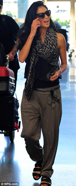 Delighted: Scherzinger leaves Los Angeles airport LAX yesterday with a wide smile on her face
