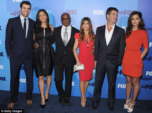 The big reveal: Steve Jones, Scherzinger, L.A Reid, Paula Abdul, Simon Cowell and Cole pose as they prepare to record the first audition show last month